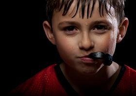 Young boy footblall player sweating with mouth guard